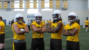 From left to right, Josh Tapscott, Shaun Wick, Brian Hill and Nico Evans have some fun posing for a picture prior to Friday's spring practice in Laramie. Photo by Robert Gagliardi/WyoSports.