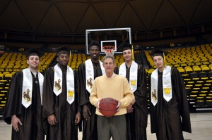 From left to right, Jack Bentz, Charles Hankerson Jr., Derek Cooke Jr., Larry Nance Jr. and Riley Grabau pose with coach Larry Shyatt as all five Wyoming men's basketball seniors will receive their degrees this weekend. Photo from UW.