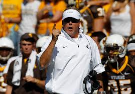 Former Wyoming football coach Dave Christensen was hired as offensive coordinator at Utah Friday.